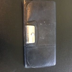 Black leather coach wallet. Fair condition.